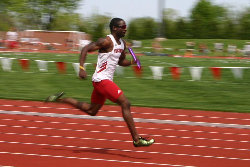 Relay Runner training on running track