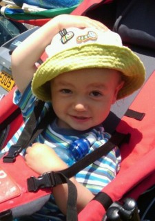 Young child wearing a sun hat