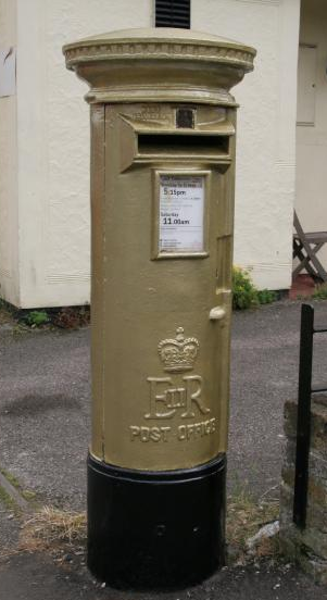 Ben Mahers Gold Post Box in Elsenham village