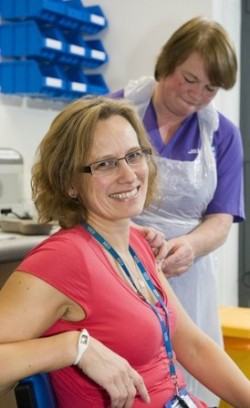NHS worker receiving a flu jab prior to the 2011 Influenza Pandemic Preparedness Consultation