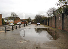 flooded road, blocked drains