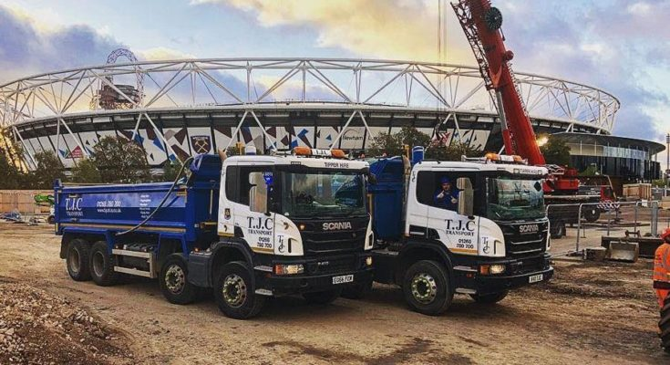 lorries carrying building materials